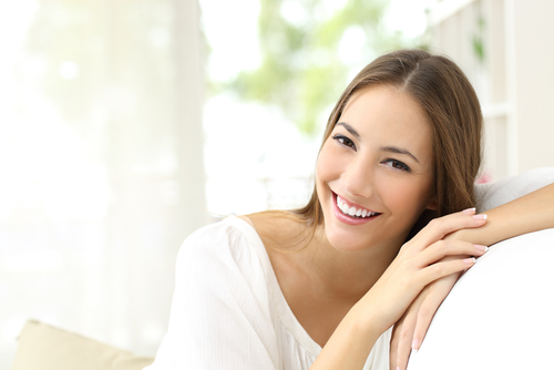 Woman smiling casually with chiseled facial features