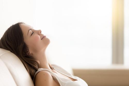 young woman enjoying rest on comfortable sofa-img-blog